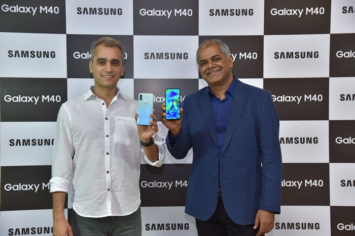 (L-R) Asim Warsi, Senior Vice President of Samsung India, and Manish Tiwary, Vice President, Category Management, Amazon India at the smartphone launch in India.