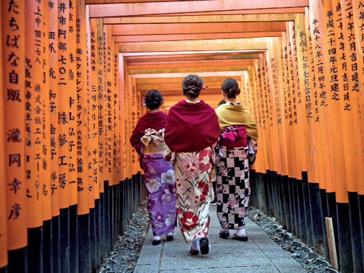 Fushimi Inari Shrine: Tourists love to sport a kimono when they walk through the torii gates at Fushimi Inari Shrine in Kyoto. Have you tried it yet?