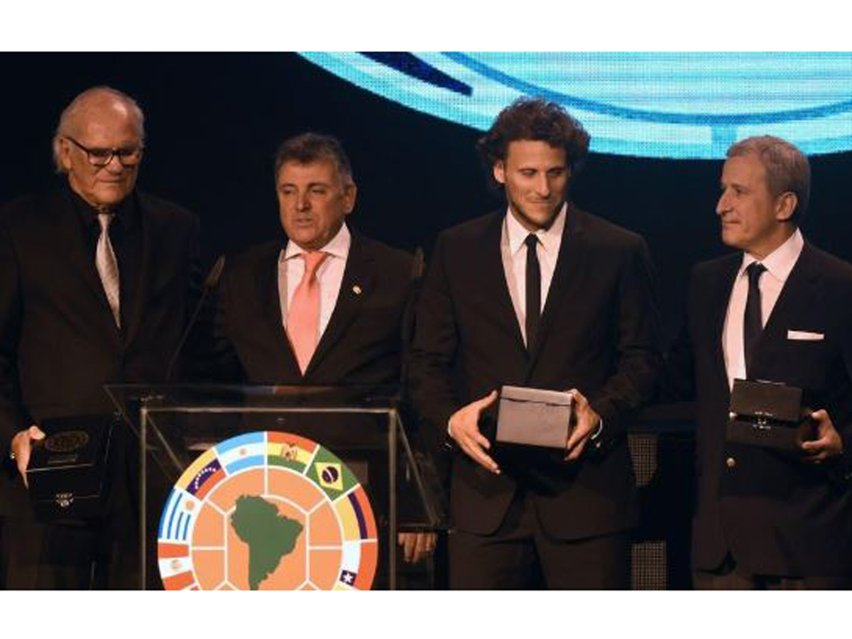 Diego Forlan and his father, Pablo, left, after they were decorated for an outstanding football career of three generations - together with Forlan's maternal grandfather Juan Carlos Corazzo - during the Copa Libertadores 2016 draw.