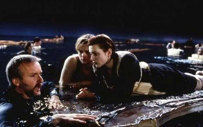 ​Director James Cameron (L) briefing Leonardo DiCaprio (C) and Kate Winslet (R) during the shooting of 1997​ classic 'Titanic'.